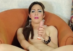 Mature asian tranny tugs on her ding-dong